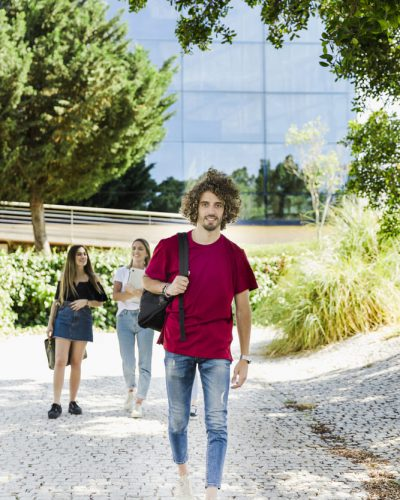student-walking-campus-with-backpack